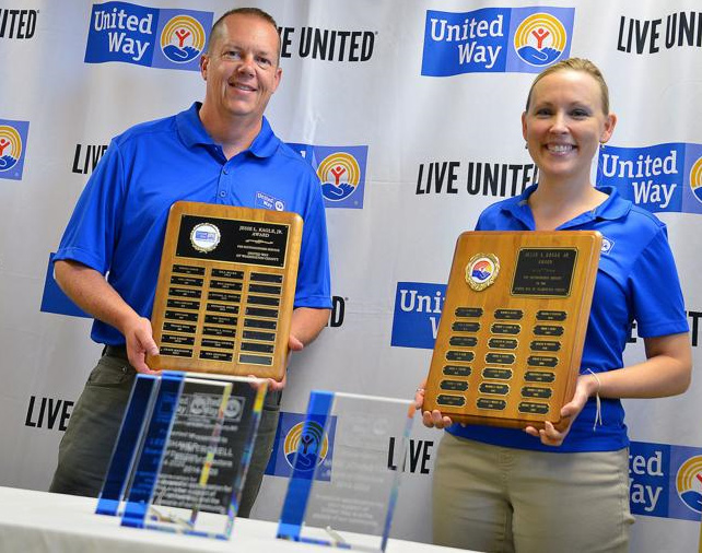 Chuck Eichelberger poses with United Way President and CEO Heather Guessford