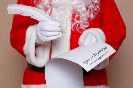 Image of Santa checking his list