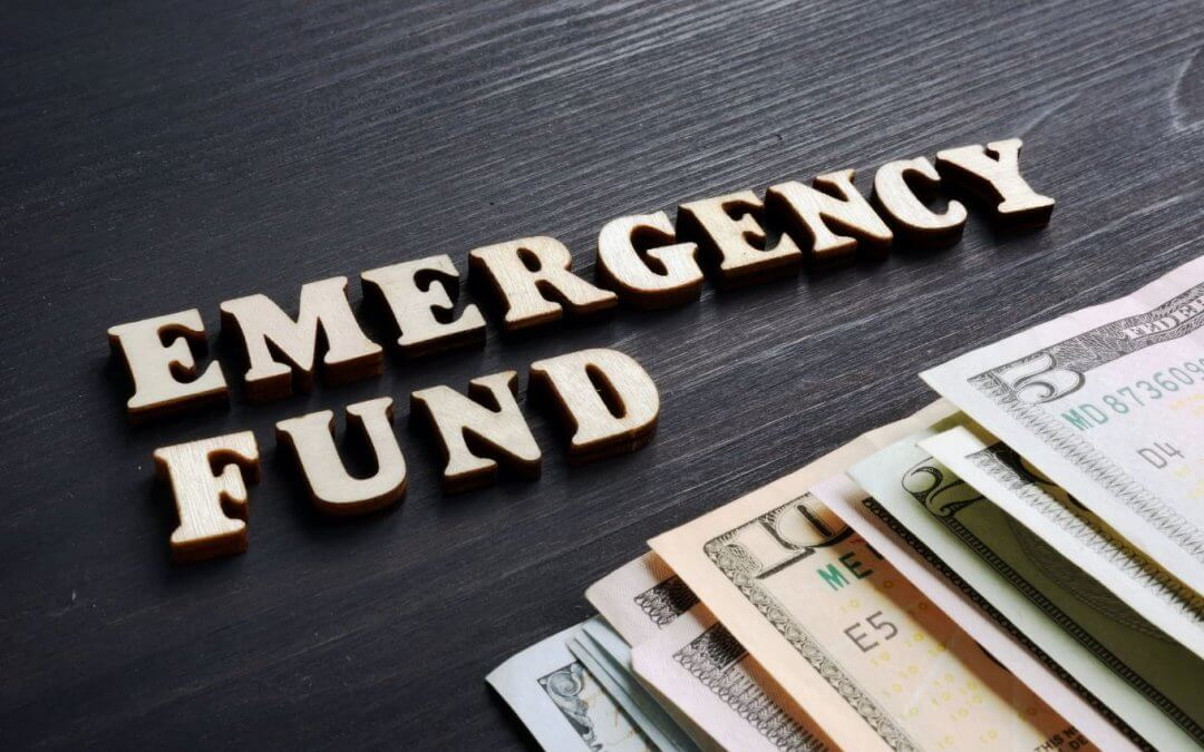 Image of the words Emergency Fund and money
