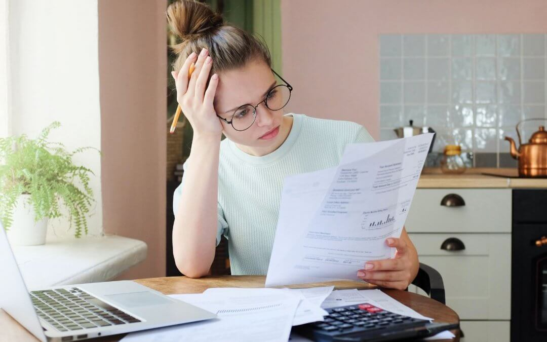 Woman reviewing loan statements